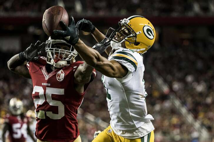 Wide receiver Trevor Davis (11) of the Green Bay Packers attempts to make a catch in the end zone as he is being defended by cornerback Jimmy Ward (25) of the San Francisco 49ers during the second quarter of their NFL preseason game at Levi's Stadium in Santa Clara, Calif. on Friday, Aug. 26, 2016.