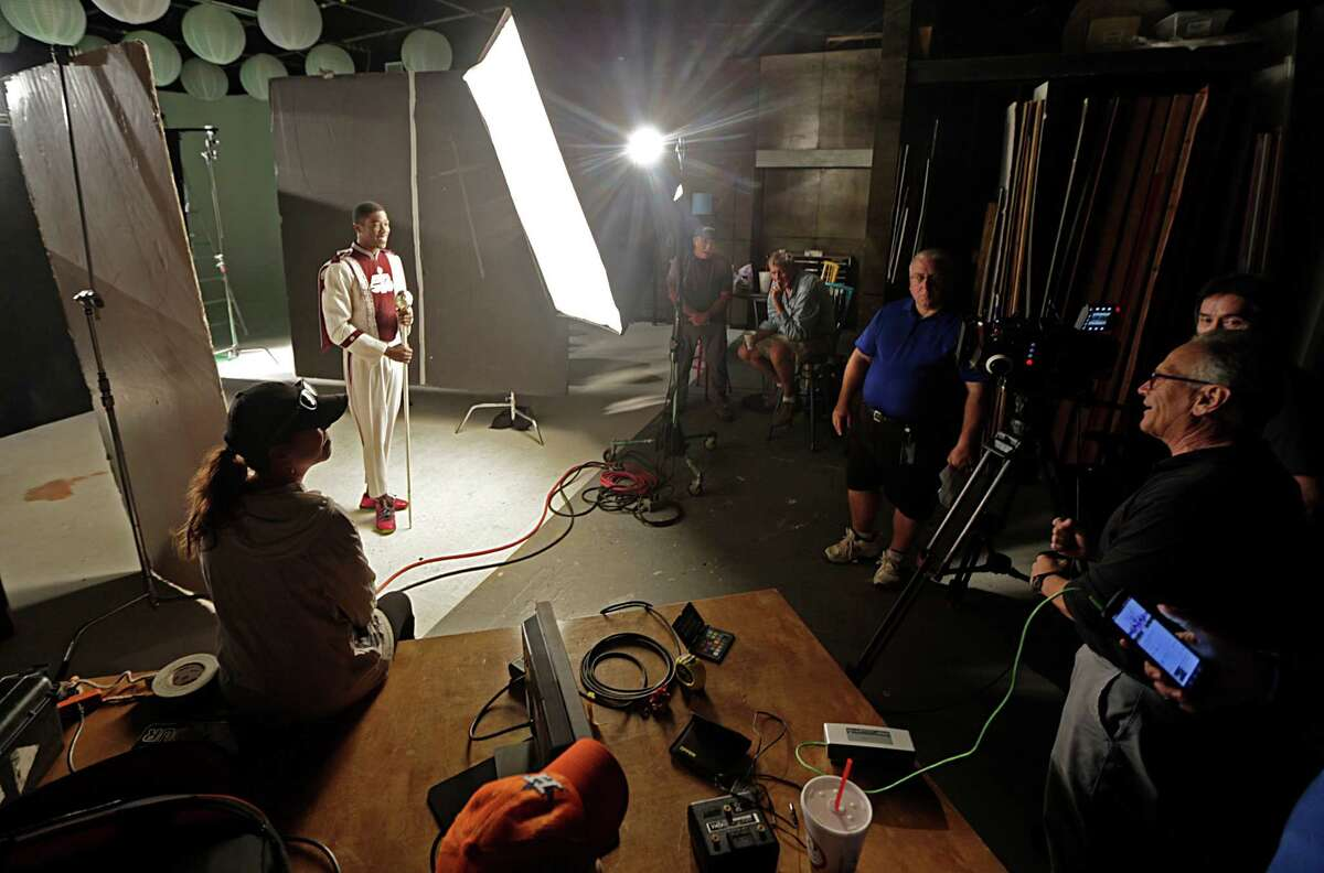 Kashmere High School drum major Zackery Johnson takes part in the filming of a commercial this month at South Coast Film & Video in Houston. By one estimate, film business in Houston has a local economic impact that's as high as $60 million a year.