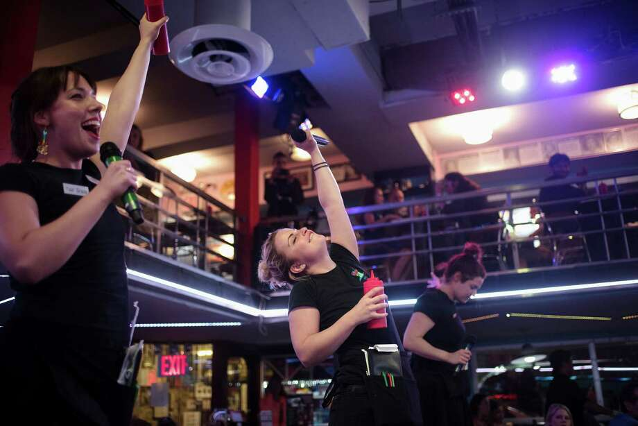 """Atop vinyl banquettes, Kristine Bogan, center, and two fellow waitresses perform the Twisted Sister hit """"We're Not Going to Take It,"""" at Ellen's Stardust Diner in New York, Aug. 22, 2016. On Friday, workers at Ellen's said they had formed a union to fight new policies that they said had led to many firings and fundamentally altered what had been a haven for performers. (Hilary Swift/The New York Times) ORG XMIT: XNYT163 Photo: HILARY SWIFT / NYTNS"""