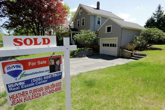 "FILE - This Wednesday, May 18, 2016, file photo shows a ""Sold"" sign in front of a house in Walpole, Mass. On Wednesday, Aug. 24, 2016, the National Association of Realtors reports on sales of existing homes in July. (AP Photo/Steven Senne, File)"