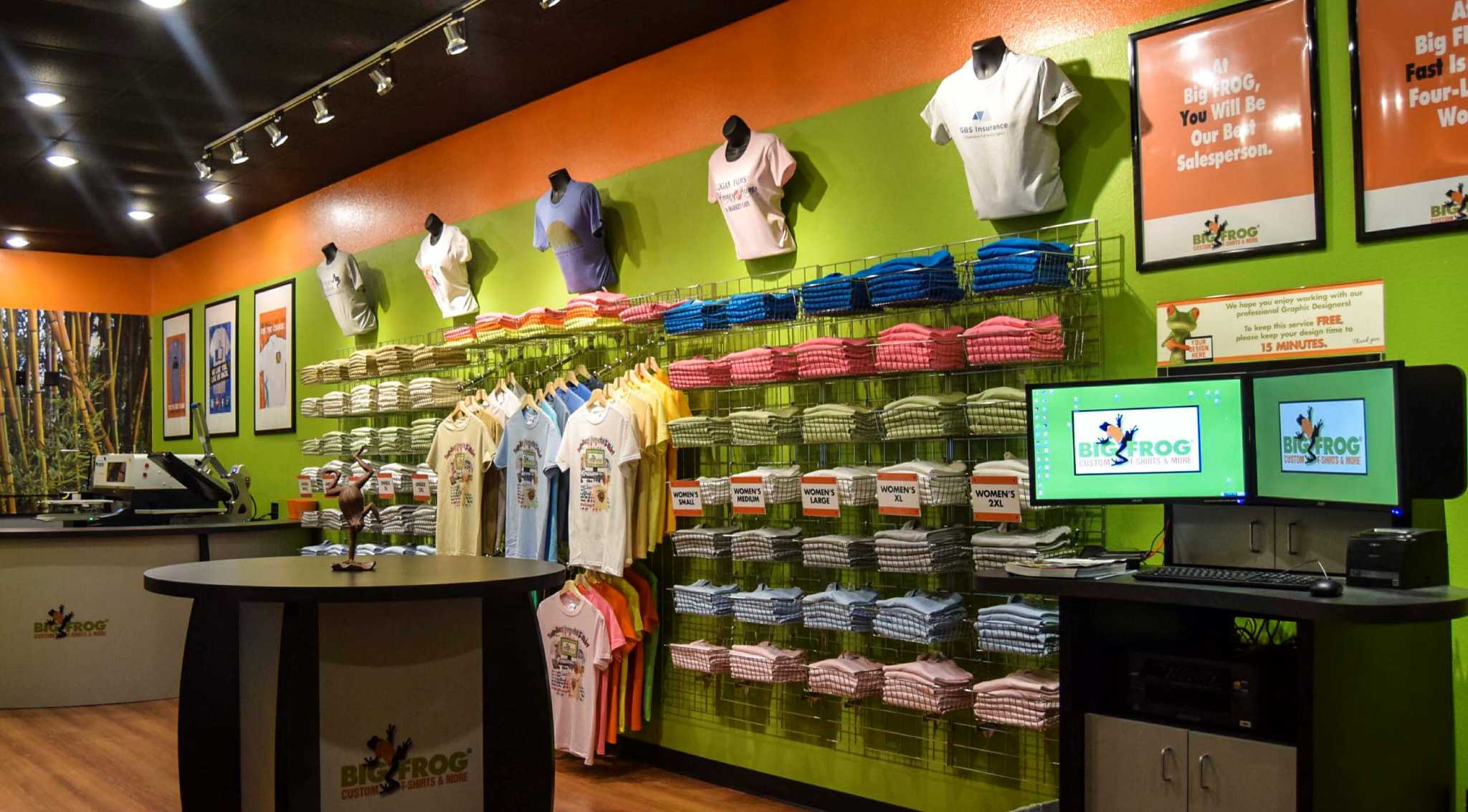 Retail wrap big frog lets customers decorate their own for Make t shirts for your business