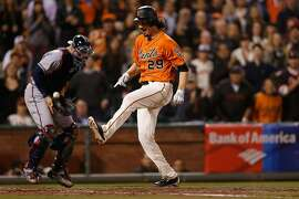 SAN FRANCISCO, CA - AUGUST 26: Jeff Samardzija #29 of the San Francisco Giants crosses home plate to score in the fourth inning against the Atlanta Braves at AT&T Park on August 26, 2016 in San Francisco, California. (Photo by Lachlan Cunningham/Getty Images)