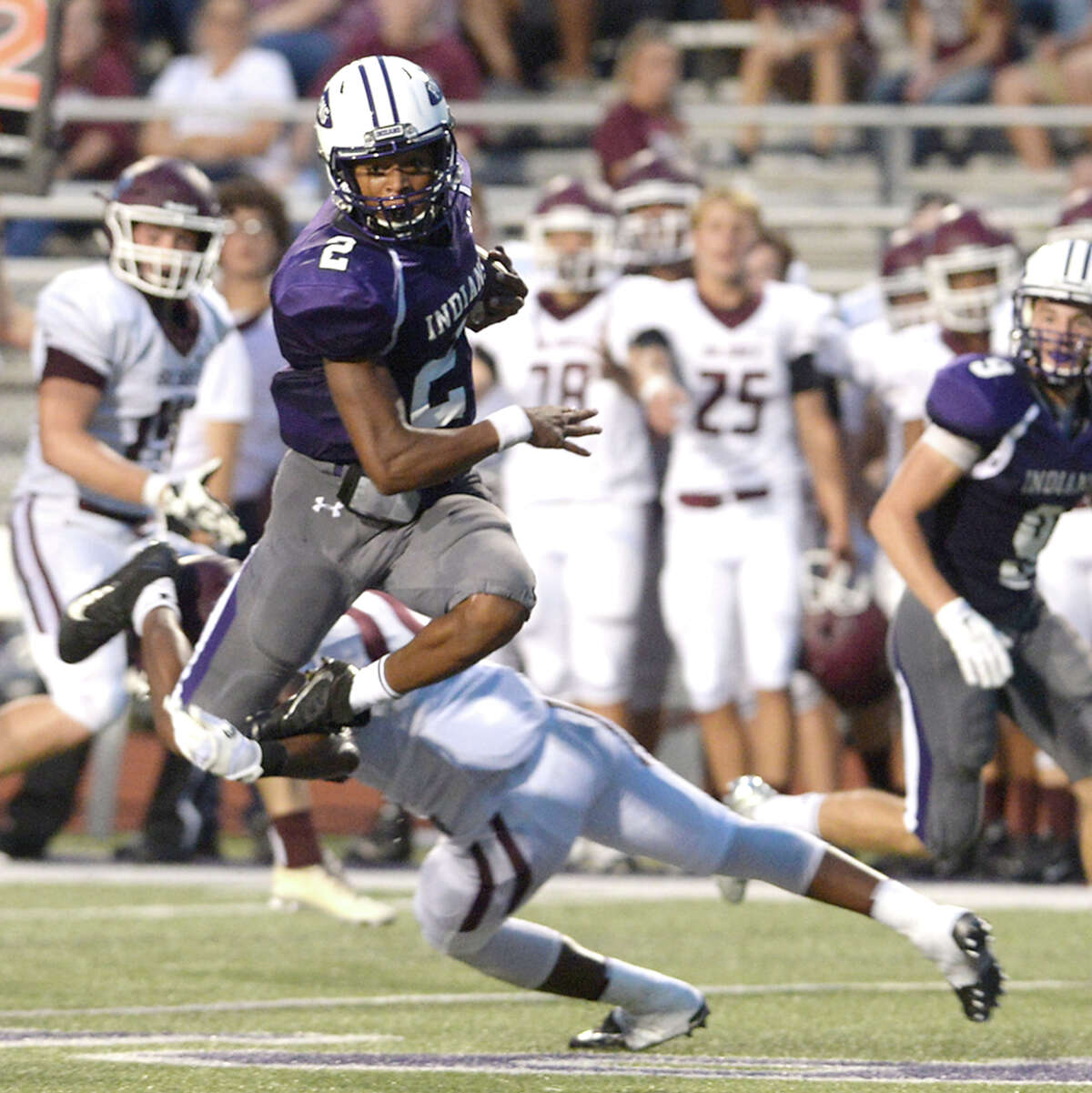 Port Neches - Groves' Roschon Johnson soars over top of Silsbee's defense as he brings the ball down to the end zone during Friday night's season opening game at PNG. Photo taken Friday, August 26, 2016 Kim Brent/The Enterprise