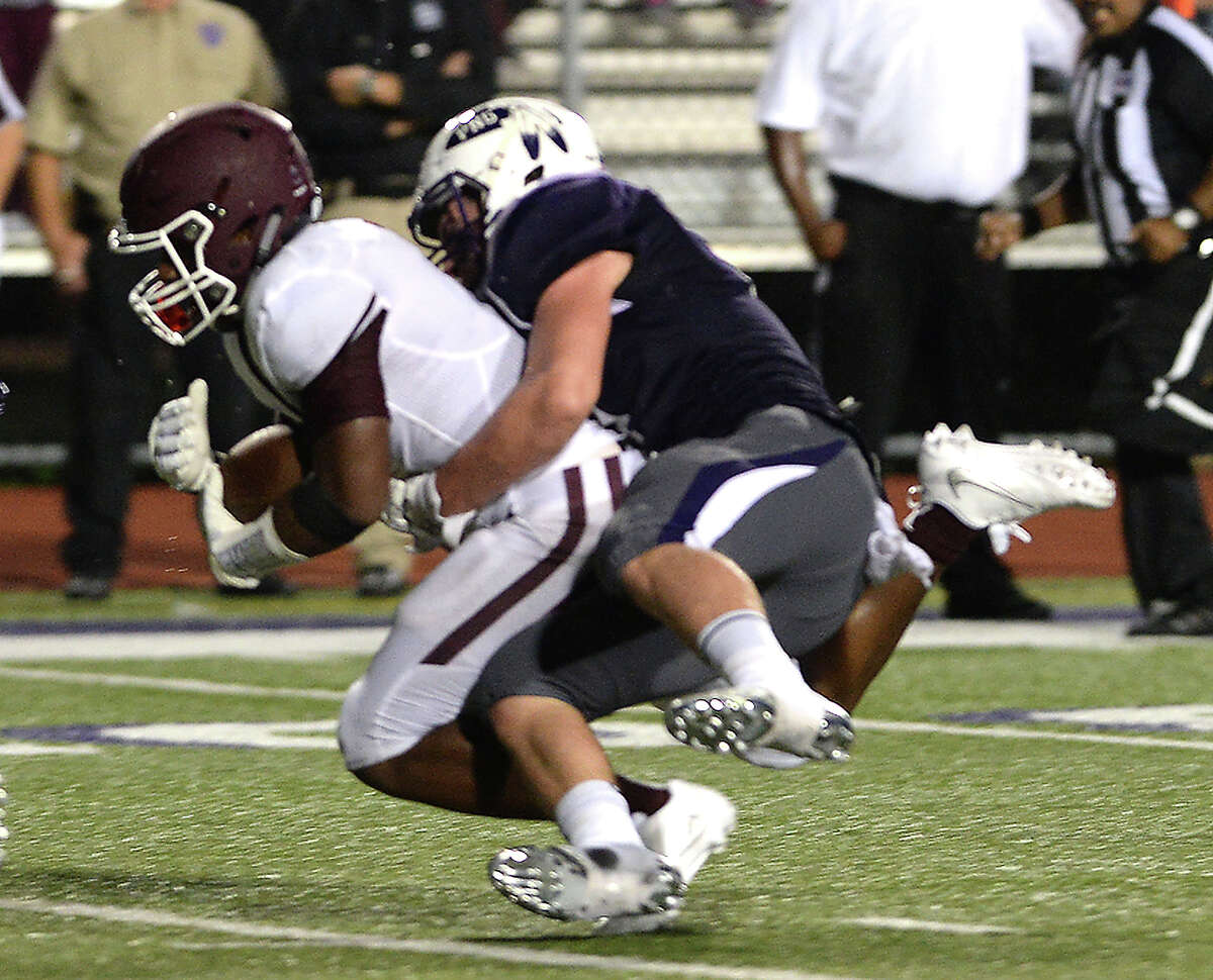 Silsbee's Calvin Tyler is taken down by Port Neches - Groves' Alec Lebouef during Friday night's season opening game at PNG. Photo taken Friday, August 26, 2016 Kim Brent/The Enterprise