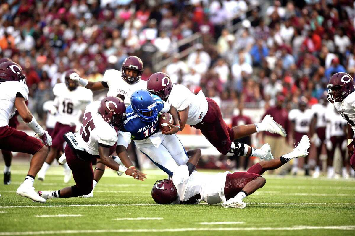 West Brook's Marcus Johnson runs for a short gain agaisnt Central during Friday night's game at the Thomas Center in Beaumont. (Guiseppe Barranco/The Enterprise)