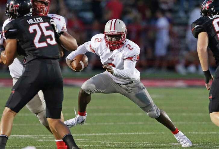 Rocket quarterback Julon Williams takes a long step off a fake as Judson plays Lake Travis at Cavalier Stadium in Austin on August 26, 2016