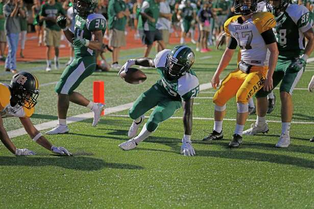 Reagan's Marquis Duncan (22) scores a touchdown on a short yardage play against Brennan after he ran 84 yards to set up the Rattlers first score at Heroes Stadium on Friday, Aug. 26, 2016. (Kin Man Hui/San Antonio Express-News)