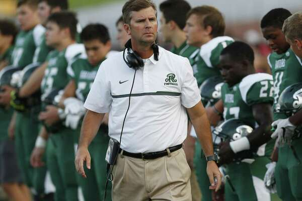 Reagan coach David Wetzel paces the sideline during the game against Brennan at Heroes Stadium on Aug. 26, 2016.