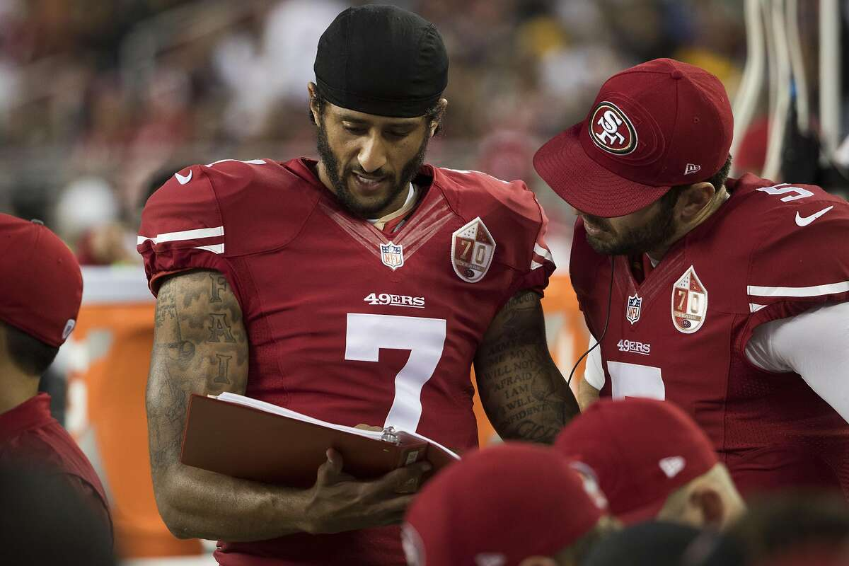Quarterbacks Colin Kaepernick (7) and Christian Ponder (5) of the San Francisco 49ers are seen on the sideline during the second quarter of his NFL preseason game against the Green Bay Packers at Levi's Stadium in Santa Clara, Calif. on Friday, Aug. 26, 2016.