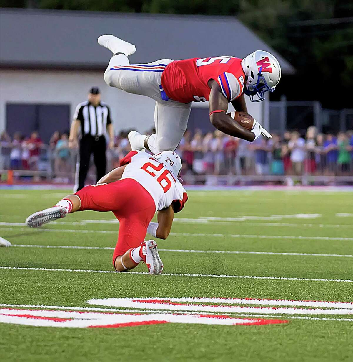 Katy's Felipe alvear 926) shoestring tackles Westlake's Nakia Watson (25) during the first football game of the season with the Katy High School Tigers and the Westlake High School Chaparrals played in Austin, Texas, at the Westlake Stadium Friday August 26, 2016.