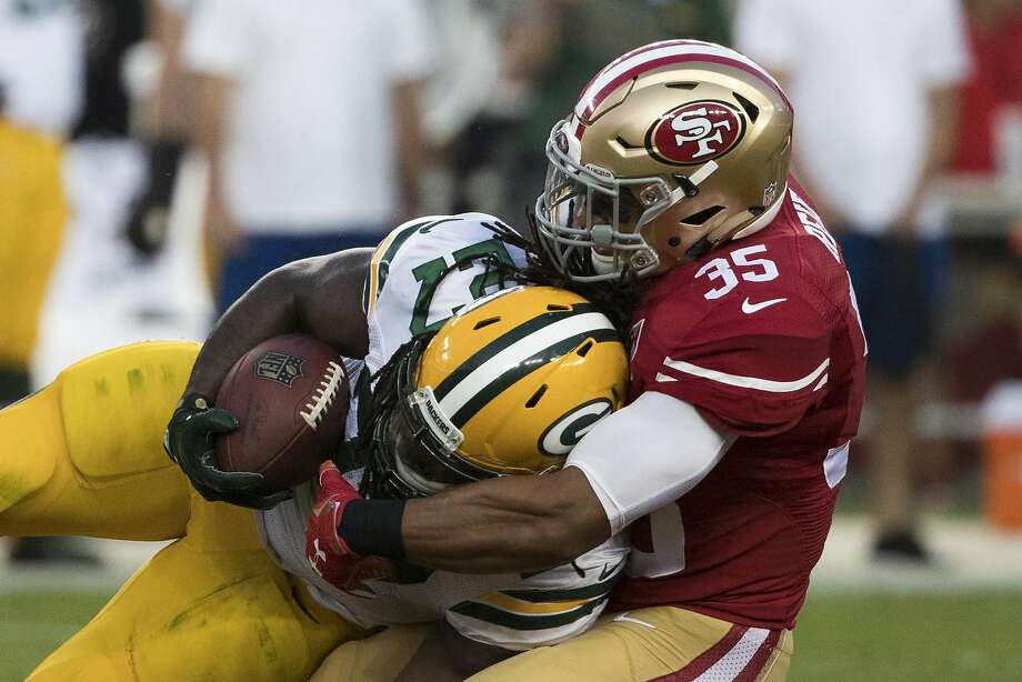 Green Bay Packers running back Eddie Lacy (27) drives the ball as he is being tackled by safety Eric Reid (35) of San Francisco 49ers during the first quarter of their NFL preseason game at Levi's Stadium in Santa Clara, Calif. on Friday, Aug. 26, 2016. The Packers defeated the 49ers 21-10. Photo: Stephen Lam, Special To The Chronicle