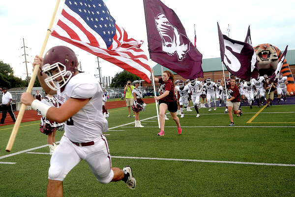 Silsbee's Tigers emerge on the field against Port Neches - Groves during Friday night's season opening game at PNG. Photo taken Friday, August 26, 2016 Kim Brent/The Enterprise