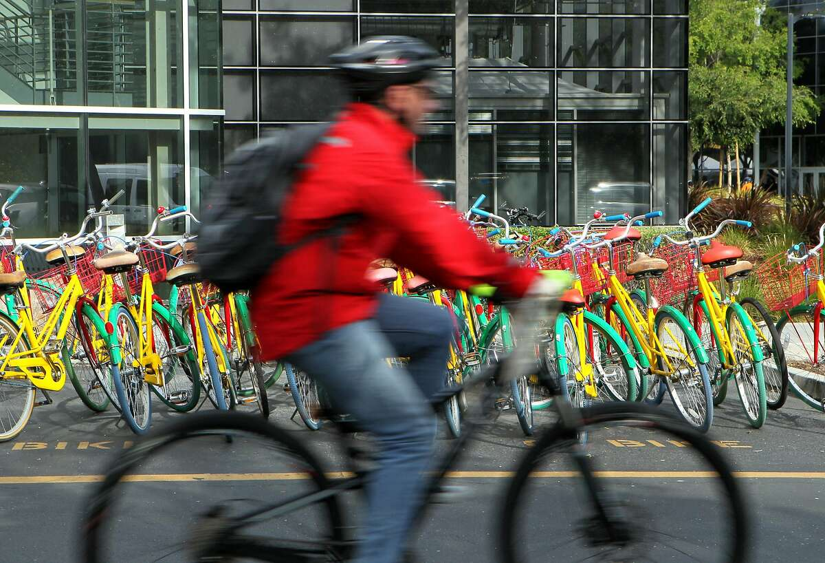 A cyclist makes his way around during Bike to Work Day at the Googleplex, Thursday, May 14, 2015, in Mountain View, Calif.