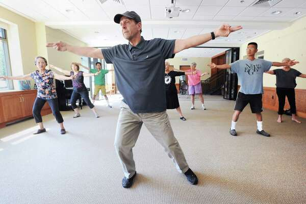 """The Tai Chi for Everyone class lead by instructor Ken Dolan, pictured here at center, at the Byram Shubert Library in Greenwich, Conn., Saturday morning, Aug. 27, 2016. Byram Shubert Library Branch Manager Miguel Garcia-Colon said that the Tai Chi classes that Dolan runs at the library are very popular """"we even added a Stars Wars Tai Chi class for kids on Monday Oct. 24, at 3 p.m."""" Dolan said Tai Chi originated in China and is a relaxing form of exercise that almost everyone can participate in. Dolan said the next class for adults will be Saturday, Oct. 1, at Byram Shubert Library at 10:30 a.m."""