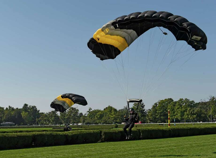 The West Point Black Knights skydiving team grace the sky above the turf course on Travers Day at the Saratoga Race Course August 26, 2016 in Saratoga Springs, N.Y.    (Skip Dickstein/Times Union) Photo: SKIP DICKSTEIN / 20037808A