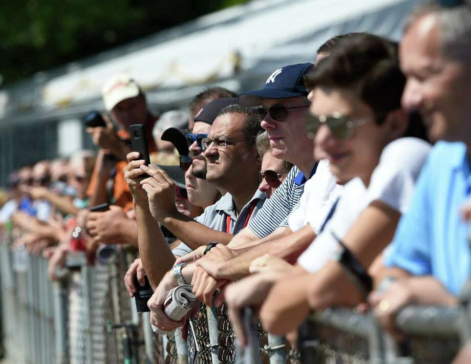 Patrons are lined up on the rail on Travers Day at the Saratoga Race Course August 26, 2016, in Saratoga Springs, N.Y.    (Skip Dickstein/Times Union) Photo: SKIP DICKSTEIN / 20037808A