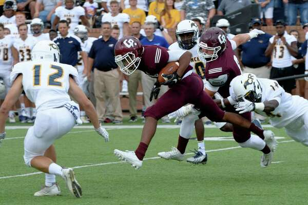 Greg Williams (1) of the Cinco Ranch Cougars returns the Cy Ranch Mustang's  kickoff during the first quarter of a high school football game on Friday, August 26, 2015 at Rhodes Stadium.