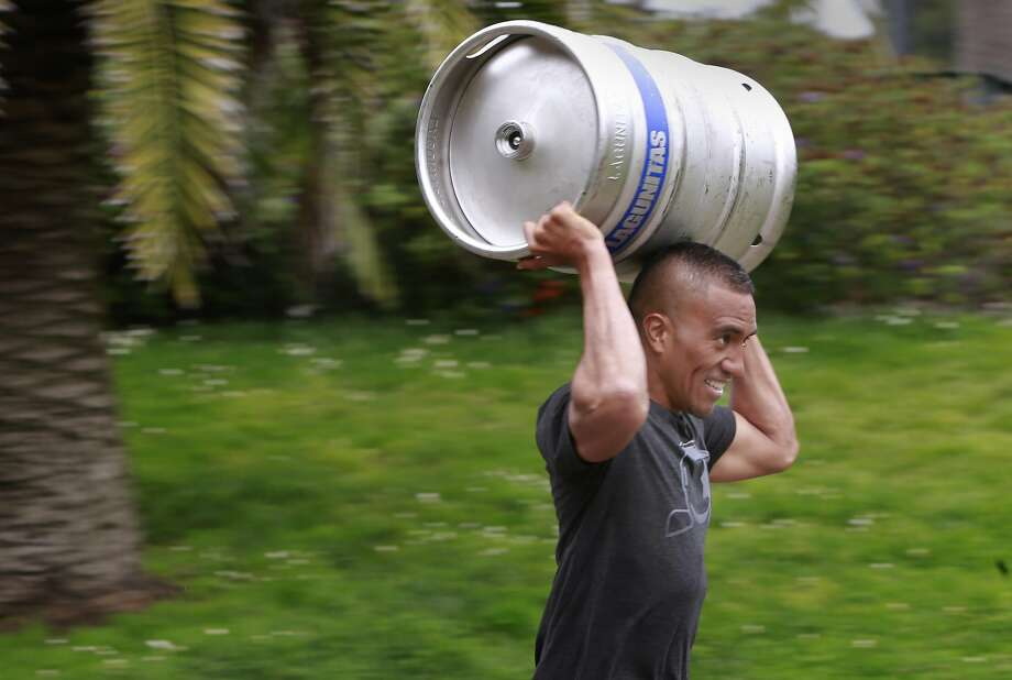 Hank Frost of San Francisco participates in the keg carry and run competition at the 420 Games. Photo: Michael Macor, The Chronicle
