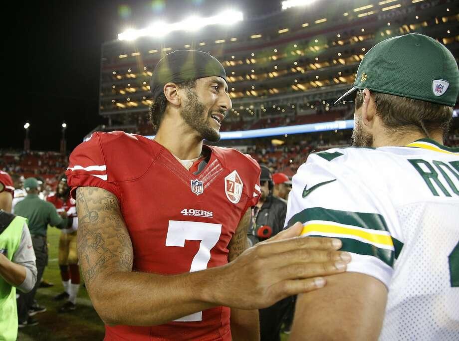 Colin Kaepernick greets Packers quarterback Aaron Rodgers on Friday night. Photo: Tony Avelar, Associated Press
