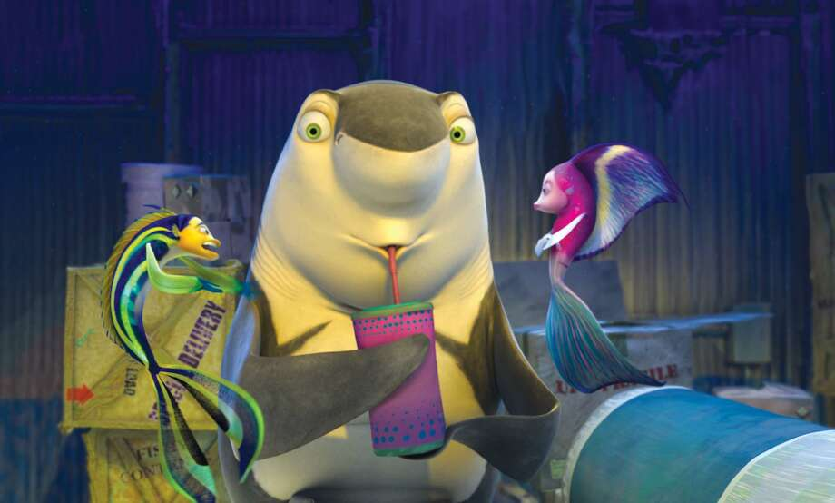 "Oscar (Will Smith, left) tries to explain to Angie (Renee Zellweger) why he is hiding a shark named Lenny (Jack Black) in DreamWorks comedy ""Shark Tale.""  (AP Photo/ DreamWorks Animation) / DREAMWORKS"
