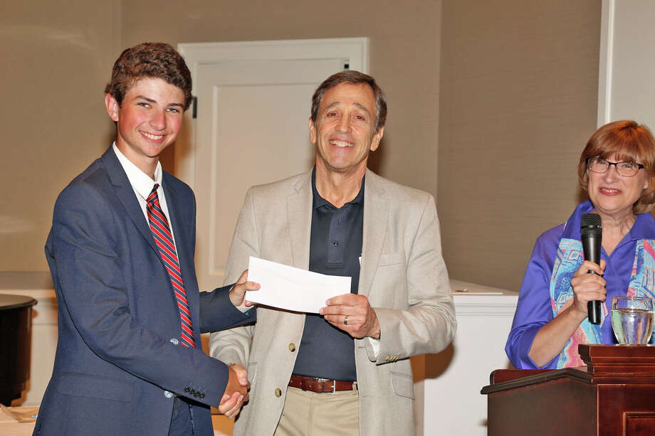 Martin D. Schwartz, center, President and CEO of The Kennedy Center, presented Noah Lomnitz of Westport, left, a student at Staples High School, with a scholarship at Shorehaven Golf Club in Norwalk. Photo: Picasa / Contributed Photo / Westport News Contributed