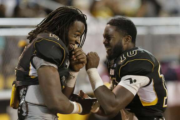 Antioch's Najee Harris, 2  and Omari Harris, 10 share a laugh late in the game as the Antioch High School Panthers take on the Trojans of Lincoln (Stockton) High in the season opener in Antioch, California on Fri. August 26, 2016.