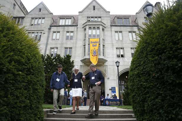 David Juhl (right), a resident of Bowles Hall in 1983, walks down the staircase in front of Bowles with his son Justin and David's mother Claudia, after touring the building at UC Berkeley on Aug. 27, 2016. David's father Ralph was also a resident of Bowles in the 50's. The castle-like residence hall underwent a year-long extensive restoration and reopens as a residential college housing as many as 183 undergraduate students.