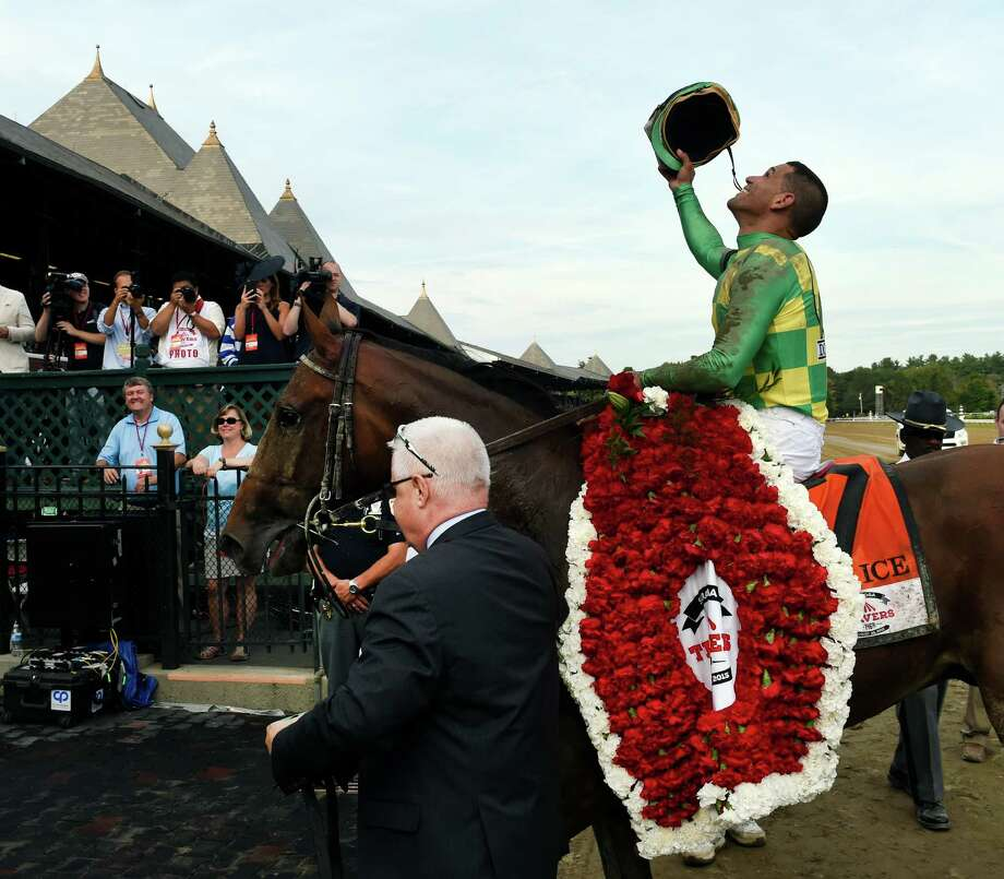 #7 Keen Ice with jockey Javier Castellano, is lead to the winner's circle by Donegal Racing's managing partner Jerry Crawford after his charge won the 146th running of the Travers Stakes Saturday evening Aug. 29, 2015 at the Saratoga Race Course in Saratoga Springs, N.Y.    (Skip Dickstein/Times Union) Photo: SKIP DICKSTEIN / 00033110A