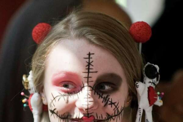 Fifteen-year-old Tresa Ashman creatively painter her face for the third annual Connecticut Horror Festival held at the Matrix Corporate Center in Danbury. Saturday, Aug. 27, 2016