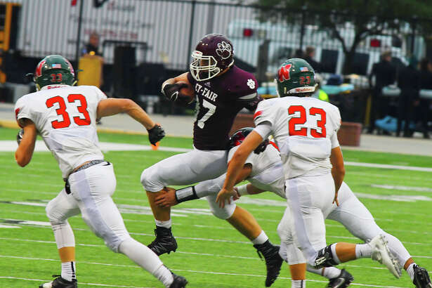 Cy-Fair tight end Brock Wright looks for room against The Woodlands' defense Friday night.