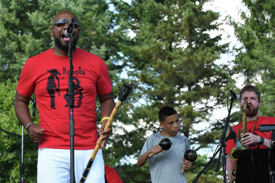 Ronald Polo, left, and the band Grupo Rebolu perform during the 21st Annual Albany LatinFest at Washington Park on Saturday Aug. 27, 2016 in Albany, N.Y. (Michael P. Farrell/Times Union) Photo: Michael P. Farrell / 20037765A