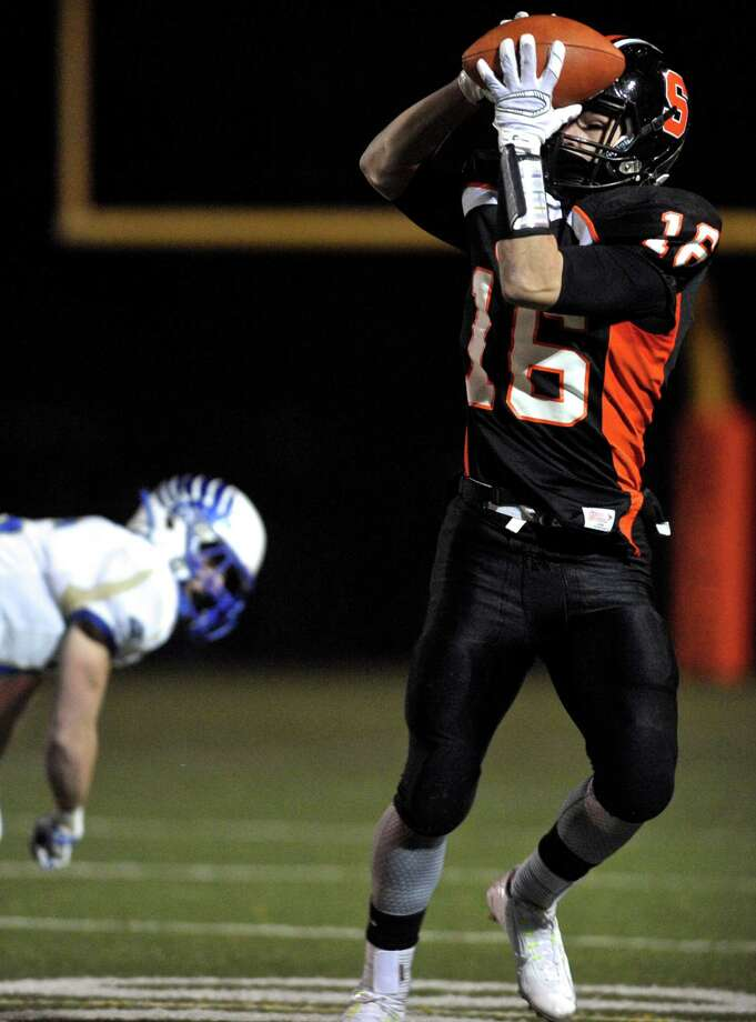 Shelton's Anthony Schiavo (16) pulls in a pass in the first half of the Conn Class LL football semifinals game between Newtown and Shelton high schools, on Monday night, December 7, 2015, at Shelton High School, Shelton, Conn. Photo: H John Voorhees III / Hearst Connecticut Media / The News-Times