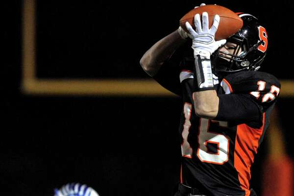Shelton's Anthony Schiavo (16) pulls in a pass in the first half of the Conn Class LL football semifinals game between Newtown and Shelton high schools, on Monday night, December 7, 2015, at Shelton High School, Shelton, Conn.
