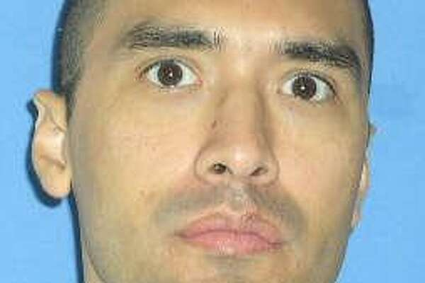 This photo released by the Texas Department of Criminal Justice shows death row inmate Rolando Ruiz who is scheduled for execution at the state prison in Huntsville, Tuesday, July 10, 2007. Ruiz, 35, is set to die for the July 1992 murder of Theresa Rodriguez in San Antonio. The murder-for-hire was arranged, according to investigators, so Michael Rodriguez could collect at least a quarter-million dollars in life insurance coverage on his wife. (AP Photo/Texas Department of Criminal Justice)