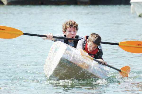 The kayak propelled by Griffin Gigliotti, front, and Angus Manion, had a brief precarious moment Saturday.