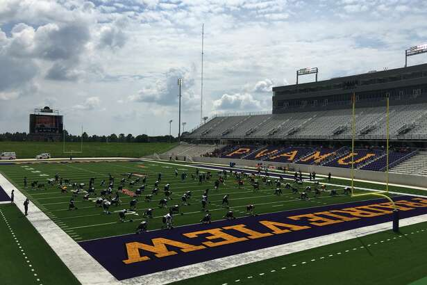The Prairie View A&M football team stretches in its new $61 million stadium on Saturday afternoon.