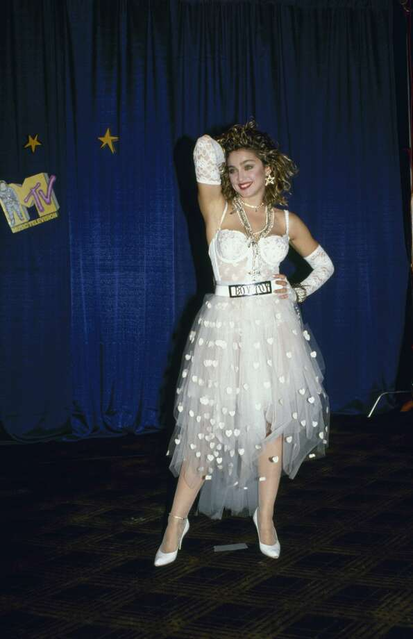 1984:American singer and actress Madonna, dressed in white lace lingerie, pearls, and a 'Boy Toy' belt buckle, stands with one hand on her head and one on her hip at First Annual MTV Video Music Awards. Photo: David McGough/The LIFE Picture Collection/Getty Images