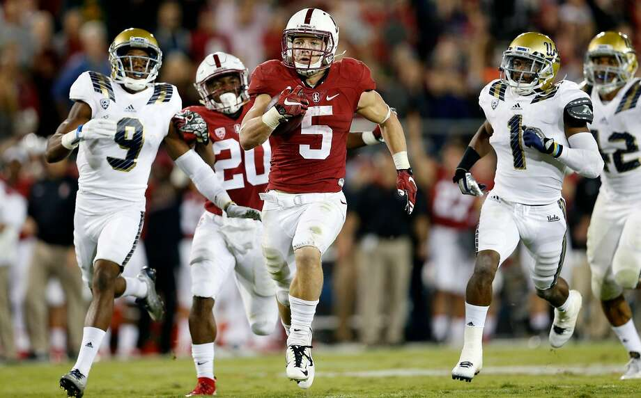 Stanford's Christian McCaffrey scores on a 70-yard touchdown run as UCLA's Marcus Rios trails the play in 3rd quarter during Pac 12 football game at Stanford Stadium in Stanford, Calif., on Thursday, October 15, 2015. Photo: Scott Strazzante, The Chronicle