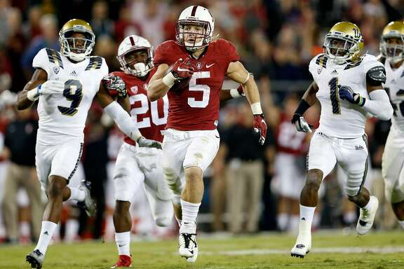 Stanford's Christian McCaffrey scores on a 70-yard touchdown run as UCLA's Marcus Rios trails the play in 3rd quarter during Pac 12 football game at Stanford Stadium in Stanford, Calif., on Thursday, October 15, 2015.