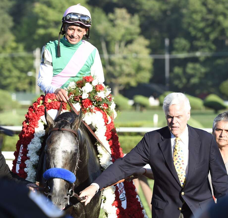 Arrogate, with jockey Mike Smith, wins the Travers on Saturday at Saratoga Race Course. (Skip Dickstein / Times Union)