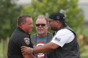 Cleveland ISD Police Chief Rex Evans gets a hug from a member of the Thin Blue Line after he spoke during a one-year anniversary memorial for  slain Harris County Deputy Darren Goforth at a park renamed for him at 9402 Barker Cypress, Saturday, Aug. 27, 2016 in Houston.