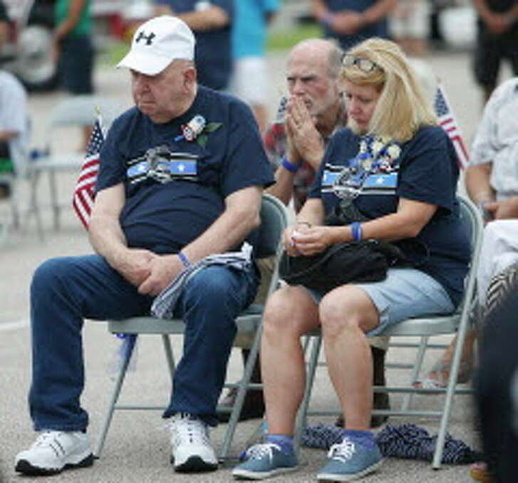 Allen Goforth and his daughter Debbie Ferguson listen during the one-year anniversary memorial for slain Harris County Deputy Darren Goforth at a park renamed for him at 9402 Barker Cypress, Saturday, Aug. 27, 2016 in Houston.