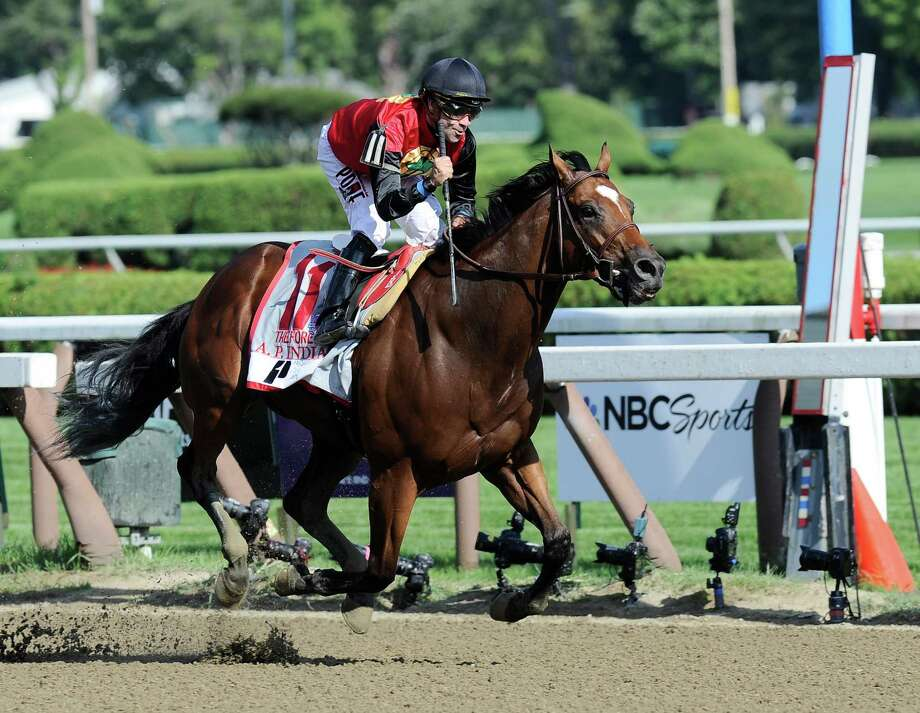 Jockey Joe Bravo, riding A. P. Indian, celebrates after winning the Priority One Jets Forego Stakes horse race at Saratoga Race Course in Saratoga Springs, N.Y., Saturday, Aug. 27, 2016. (AP Photo/Hans Pennink) Photo: Hans Pennink / FR58980 AP