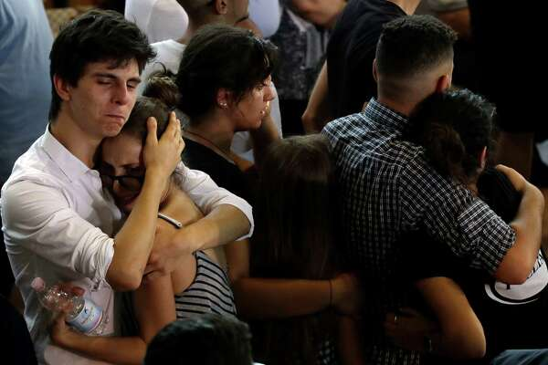Relatives and friends mourn during the state funeral service of some of the earthquake victims in Ascoli Piceno, Italy, Saturday, Aug. 27, 2016. Funerals for some victims took place on Friday, while those for many others are expected in the coming days. (AP Photo/Gregorio Borgia) ORG XMIT: GB119