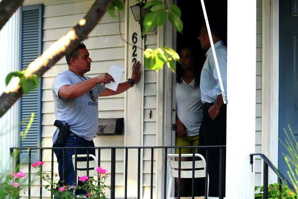 Police investigate the fatal shooting of Shane Slinsky, 18, of Stamford, on Wood Terrace in Bridgeport, Conn., on Saturday Aug. 27, 2016.