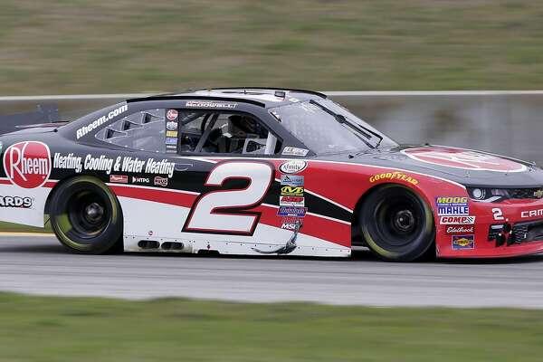 Michael McDowell (2) drives his car during the NASCAR Xfinity Road America auto race, Saturday Aug.  27, 2016 at Elkhart Lake's Road America in Elkhart Lake, Wis..  McDowell won the event. (Gary C. Klein/The Sheboygan Press via AP)
