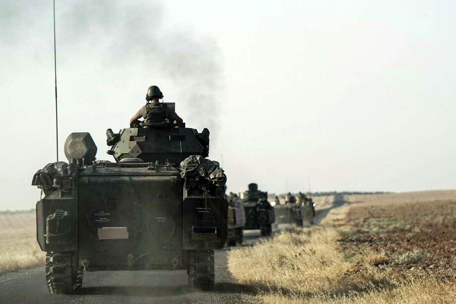 Turkish troops head to the Syrian border, in Karkamis, Turkey, Saturday, Aug. 27, 2016. Turkey on Wednesday sent tanks across the border to help Syrian rebels retake the key Islamic State-held town of Jarablus and to contain the expansion of Syria's Kurds in an area bordering Turkey .(AP Photo/Halit Onur Sandal) ORG XMIT: ANK101 Photo: Halit Onur Sandal / Copyright 2016 The Associated Press. All rights reserved. This m