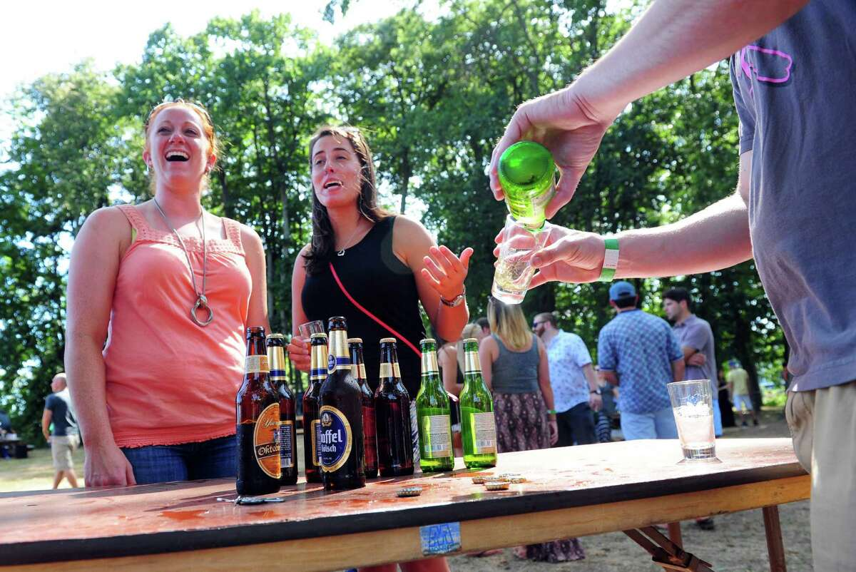 Megan Wolf, of West Hartford, left, and her friend Alyson Agler, of Stratford, try the Jever pilsner from Star Distributors at the annual ShakesBeer Festival on the grounds of the American Shakespeare Festival Theater in Stratford, Conn. on Saturday August 27, 2016. The festival showcases fine craft beers from around Connecticut as well as nearby states. The event boasts a fantastic line up of both local and regional craft breweries (more than 60 in all); a diverse range of culinary options through several renowned CT Food Trucks and live bands playing classic covers. The event is also a fundraiser for the restoration of the American Shakespeare Theater.