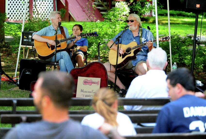 Musician Rob Carlson, right, performs with fellow musician Beth Bradley at the Greenfield Hill Grange Agricultural Fair on Hillside Road in Fairfield, Conn., on Saturday Aug. 27, 2016. There were farm and agricultural exhibits, grilled and baked goods, live poultry, games, a raffle, pony rides, live music, crafts and jewelry. Some of the exhibits and demonstrations included composting, square foot gardening, raising chickens and antique farm tools.