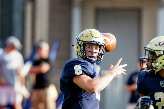 Klein Collins QB Bryson Popwers (8) throws downfield during the football game of the first half of action between Klein Collins vs. CyWoods high schools during a football game at the Memorial Stadium, Saturday, August 27, 2016, in Houston. ( Juan DeLeon/for the Houston Chronicle)